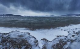 Cold beach , snow storm royalty free stock image