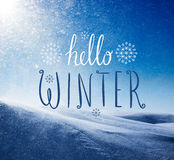 Photo of snowstorm in sunny day with Hello Winter lettering. Stock Image