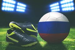 Photo of soccer boot with Russia soccer ball. In stadium Royalty Free Stock Images