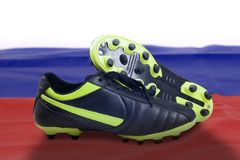 Photo of soccer boot with Russia soccer ball. In stadium Royalty Free Stock Image