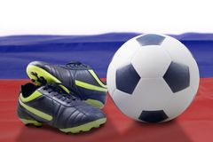 Photo of soccer boot with Russia soccer ball. In stadium Royalty Free Stock Photo