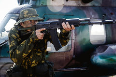 Photo of a soldier with an automatic rifle Royalty Free Stock Photography