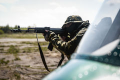 Photo of a soldier with an automatic rifle Royalty Free Stock Image
