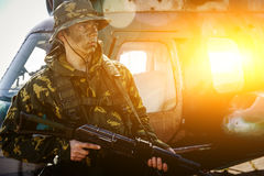 Photo of a soldier with an automatic rifle Royalty Free Stock Photos