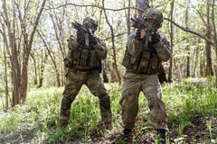 Photo of soldiers on reconnaissance. With machine guns royalty free stock photos