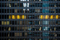 Architecture in Chicago. Windows. A photo with some blue and yellow windows. Lights inside royalty free stock photography