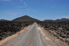 Panoramic view of the lanzarote volcanoes surrounded by solidifi royalty free stock photography