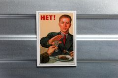 Photo Soviet propaganda poster life style. Set of soviet posters, military, life style, on metal wall Stock Images