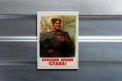 Photo Soviet propaganda poster life style. Set of soviet posters, military, life style, on metal wall Royalty Free Stock Photos