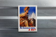 Photo Soviet propaganda poster life style. Set of soviet posters, military, life style, on metal wall Stock Photography