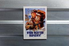 Photo Soviet propaganda poster life style. Set of soviet posters, military, life style, on metal wall Stock Photos