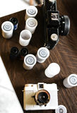 Photo spools and filn cameras on a wooden table, top view. Stock Photo