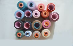 Various colored threads for cloth factory, weaving, textile production, clothing industry. stock photography
