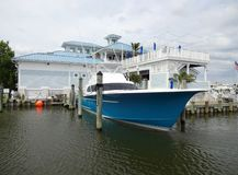 Sportfishing Boat and Marina Restaurant. Photo of sport fishing boat and marina restaurant in west ocean city maryland.  This blue boat takes people fishing for stock image