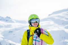 Photo of sportive man with snowboard against background of mountains. In winter Stock Images