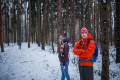Photo of sports man and woman standing in winter forest royalty free stock photo