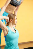 Photo of sportswoman and trainer. Practicing yoga in gym Royalty Free Stock Images
