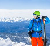 Photo of sporty man with skis. In background of mountain landscape Royalty Free Stock Photos