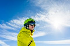 Photo of sporty man wearing mask and helmet against blue sky. During day Stock Photography