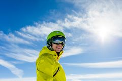 Photo of sporty man wearing mask and helmet against blue sky. During day Royalty Free Stock Photography