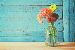 Photo of spring flowers on wooden background. vintage filtered Stock Image