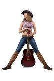 Photo of standing cowgirl with the guitar Royalty Free Stock Photo