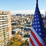 The Stars and Stripes in Brooklyn. Photo of The Stars and Stripes & x28;Flag of the United States of America& x29; with a view over the houses in Brooklyn, NYC Royalty Free Stock Image