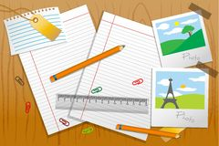 Photo with stationary and paper on table Stock Image