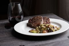 Steak, brussel sprouts, and wine stock image