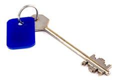 Photo of steel key with blue trinket Stock Photo