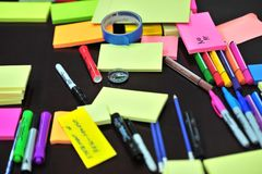 Photo of Sticky Notes and Colored Pens Scrambled on Table Stock Photos