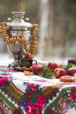 Photo of still life in the Russian style, with apples, samovar and bagels, for tea Royalty Free Stock Image