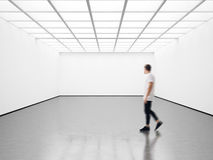 Photo of student in modern gallery looking at the empty canvas. Blank mockup, motion blur Stock Photography