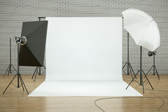 Photo studio. Empty photo studio interior with white background and lighting equipment. 3D render Royalty Free Stock Photos