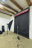 Photo Studio. The interior of the studio with lighting equipment and backgrounds royalty free stock photo