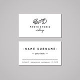 Photo studio business card design concept. Photo studio logo with hands and lens. Vintage, hipster and retro style. Black and white royalty free illustration
