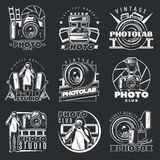 Photo Studio Emblems Set. Isolated labels set with vintage photographer elements and professional photo studio equipment monochrome on dark background vector Royalty Free Stock Photography