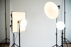 Photo studio equipment. Picture of empty photo studio with lighting equipment stock photos