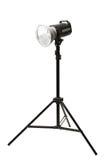 Photo studio flash light on the tripod on white Royalty Free Stock Photos