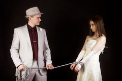 Photo studio. Groom snared rope bride. fun Royalty Free Stock Images