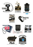 Photo studio icon set with camera, lens and film. Photo studio and photography school symbol set. Retro photo camera, digital camera lens, camera flash and film Royalty Free Stock Photography