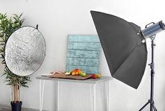 Photo studio with professional lighting equipment. While shooting food stock image