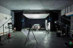 Photo Studio shooting with car and lighting royalty free stock image
