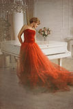 Photo stylized as old picture. Woman and piano. stock photography