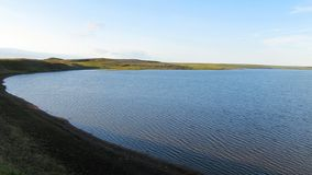 Photo of a summer lake in the mountains of the Ural tundra royalty free stock photography