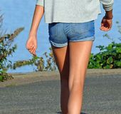 Summer suntanned legs Stock Images