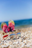 Photo of sunglasses ,flip flops Royalty Free Stock Photo