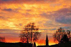 Photo of the sunrise behind a bell tower, photo taken in Mogliano Veneto, Italy.  royalty free stock image