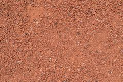 Surface with red  fine gravel on the ground royalty free stock image