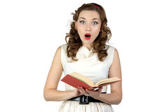 Photo of  surprised pinup woman reading book. Photo of surprised pinup woman reading book on white background Royalty Free Stock Photos
